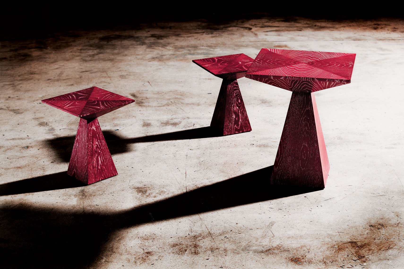 Red tables on concrete